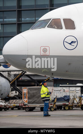 08 March 2018, Germany, Frankfurt: Sabrina Boock, in charge of ground handling operations, waits for the departure - Stock Photo