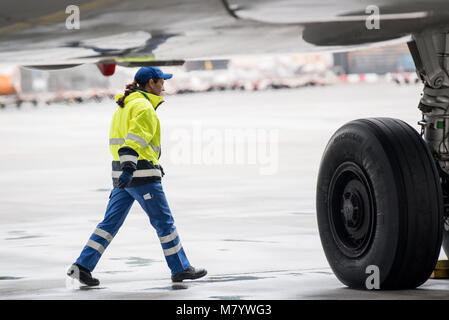 08 March 2018, Germany, Frankfurt: Sevim Sejdijaj, in charge of ground handling operations, inspects the underbody - Stock Photo