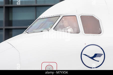 08 March 2018, Germany, Frankfurt: Lufthansa pilot Riccarda Tammerle sits in the cockpit of an Airbus A 321 passenger - Stock Photo