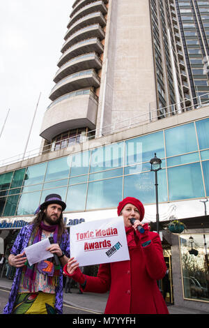 London, UK. 13th March, 2018. Campaigners for a fairer press present the Toxic Media Awards outside the Press Awards - Stock Photo