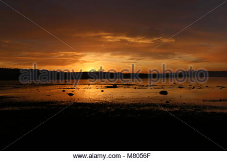 Dundee, UK. 14th March 2018. UK Weather: Sunrise over Tay Estuary, the start to a dry day in Tayside.  © Stephen - Stock Photo