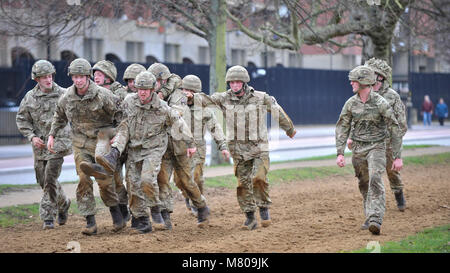 London, UK.  14 March 2018.  Members of the military take part in a physical fitness exercise in Hyde Park outside - Stock Photo