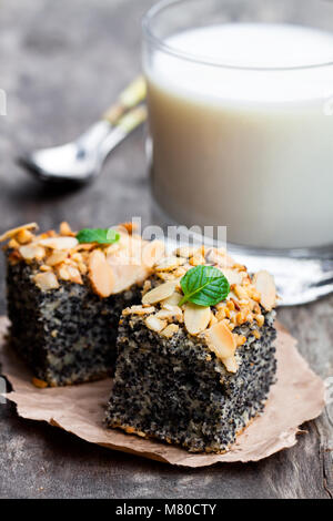 Poppy  seed pie freshly baked with fresh milk on wooden background - Stock Photo