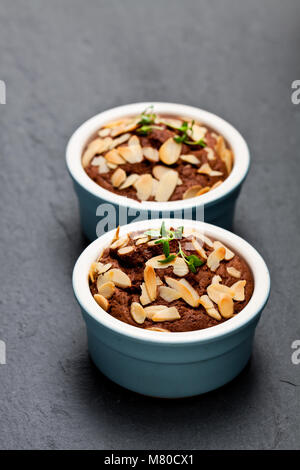Delicious  homemade chocolate muffin cake in small pot - Stock Photo