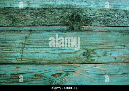 Old rustic wooden planks painted in turquoise color. Backgrounds concept - Stock Photo