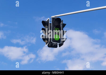 Traffic light with green light signal on sky background - Stock Photo