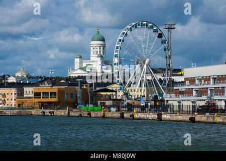Helsinki, Finland. August 26, 2017. View of Skywheel Helsinki and Helsinki Cathedral - Stock Photo