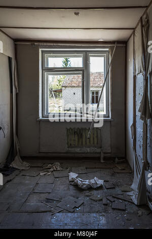 Ruined old room in the abandoned soviet building - Stock Photo
