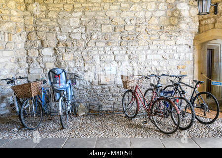 Bicycle parking space for Fellow only in the Queen's Gate at Trinity college, Cambridge University, England, on - Stock Photo