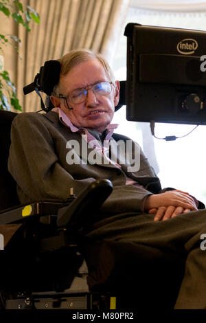 Professor Stephen Hawking speaks to media at a press conference in London 2.12.14. - Stock Photo