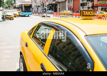 A traditional yellow taxi on the street in Istanbul, Turkey. Urban life style. Transportation of passengers. Waiting - Stock Photo