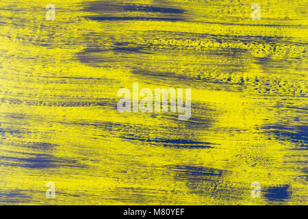 blended vertical stripes of thick paint in shades of yellow and gray on wooden plank