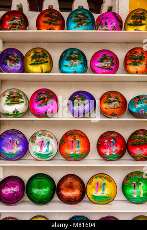 Decorated lacquered painted coconut shells for sale in a shop in Hoi An, Vietnam - Stock Photo