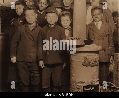 Group of Young Newsboys at 5:00 a.m. on Sunday Getting Ready to Sell Newspapers from McIntyre's Branch, Chestnut - Stock Photo