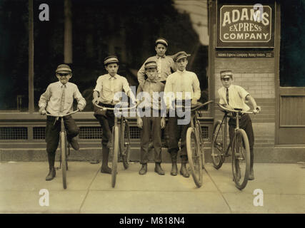 Group of Young Postal Messengers, Portrait with Bicycles, Norfolk, Virginia, USA, Lewis Hine for National Child - Stock Photo