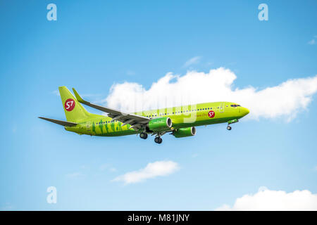 DUESSELDORF / GERMANY - OCTOBER 05 2017: Russian S7 Aerines Boeing 737 8GJ landing at Dusseldorf Airport - Stock Photo