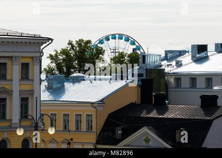 Helsinki, Finland. August 26, 2017. View of Skywheel Helsinki and buildings rooftops - Stock Photo