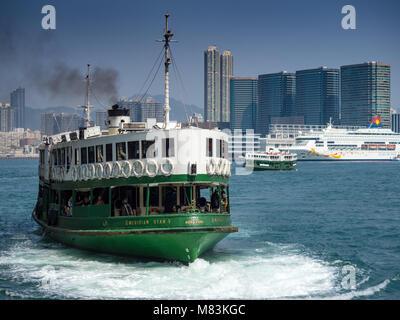 Hong Kong Star Ferry leaves Hong Kong for Kowloon - Stock Photo