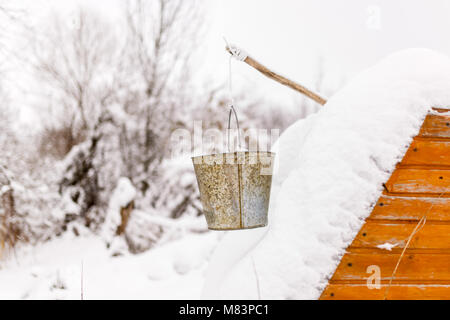 Picture of well in snow, buckets - Stock Photo