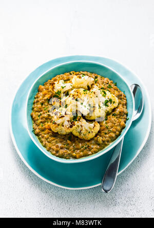 dhal of lentils with cauliflower on a table. a traditional Indian dish. vegetarian cuisine - Stock Photo