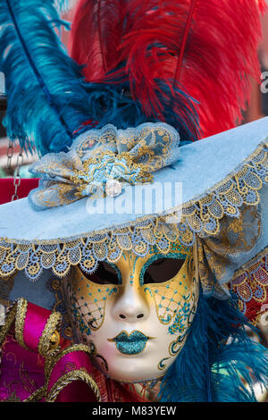 Carnival of Venice, beautiful feathered masks at St. Mark's Square - Stock Photo
