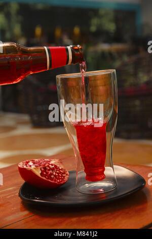 Fresh pomegranate juice in the glass jar - Stock Photo