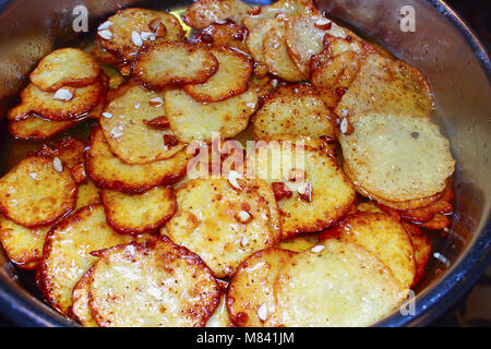 Sweet potato food dish. Potato fritters being cooked in a vending stall - Stock Photo
