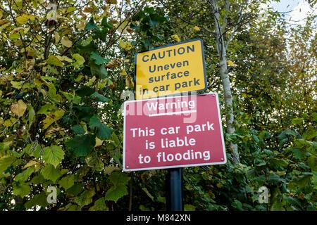 Flood warning sign at a car park, UK - Stock Photo