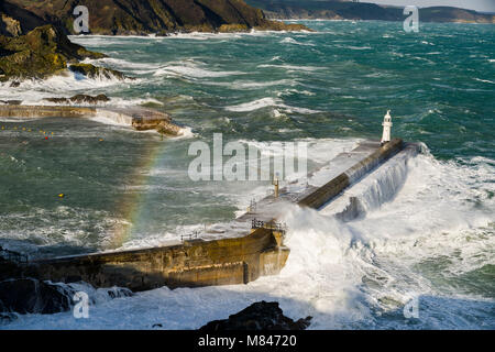 Huge swells crash into the harbour at Mevagissey in Cornwall as Storm Emma makes landfall in Cornwall. March 2018 - Stock Photo