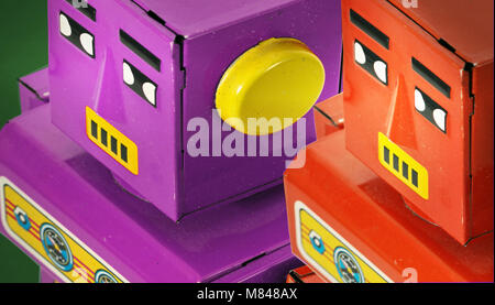 two retro robots looking on - Stock Photo