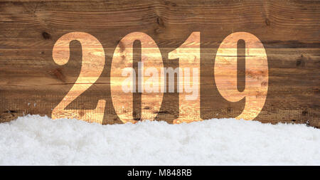 New year 2019 overlay on wooden background with snow drifts - Stock Photo