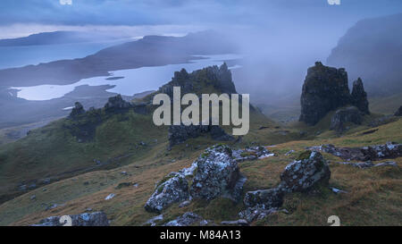 Jagged basalt peaks near the Old Man of Storr on a foggy morning, Isle of Skye, Scotland. Autumn (November) 2017. - Stock Photo