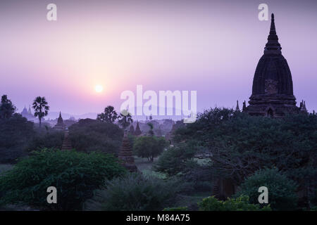 Sunset as seen from the Alo Daw Pyi Pagodas, Bagan, Myanmar - Stock Photo