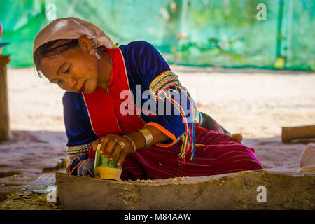 CHIANG RAI, THAILAND - FEBRUARY 01, 2018: Unidentified woman using a knife to do a handycraf with bamboo cane at - Stock Photo
