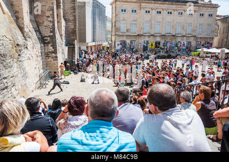 Avignon, France - July 24, 2011: Avignon, Palais Des Papes, Front Square, people watching arstists show during the - Stock Photo