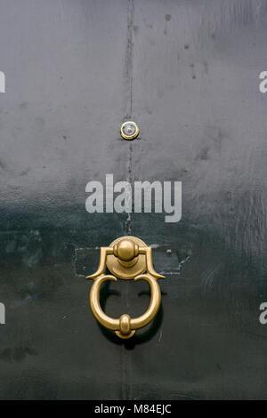... Copper Door Knocker On Wooden Door With Peephole   Stock Photo
