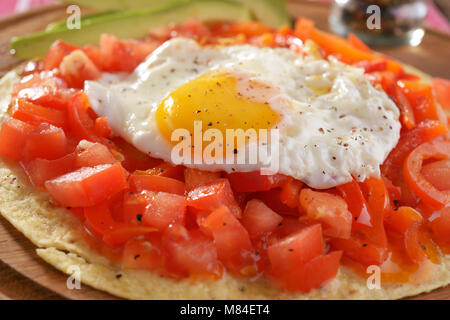 Huevos rancheros on the tortilla, the traditional Mexican breakfast dish - Stock Photo