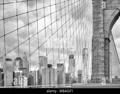 Black and white picture of the Manhattan seen from the Brooklyn Bridge, New York City, USA. - Stock Photo