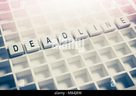 Macro Of The Word Deadline Formed By Wooden Blocks In A Typecase - Stock Photo