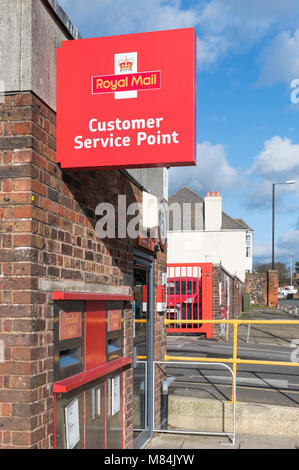 Royal Mail Post Office Customer Service Point and sign in Chichester, West Sussex, England, UK. - Stock Photo