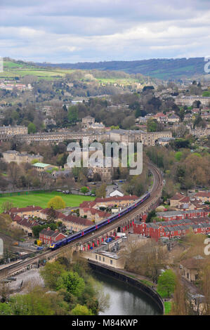 Train service for London leaves Bath station in Somerset across the railway viaduct towards the east - Stock Photo