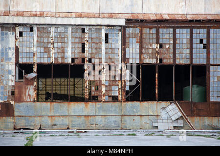 One side of the Midway seaplane hangar shelled in WWII on Dec 7, 1941 and set on fire by Japanese air attack Jun - Stock Photo