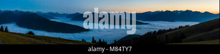 The view at dusk from Hurricane Ridge visitors center. The valleys below filled with clouds. Olympic National Park, - Stock Photo