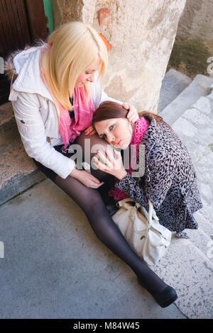 Female friends compassion protective - Stock Photo