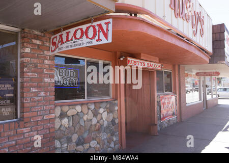 The entrance to Rusty's Saloon and grill on Main St in Bishop California. - Stock Photo