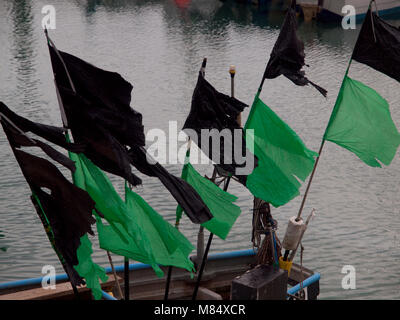 Plastic flags on a fishing boat in Brighton Marina - Stock Photo