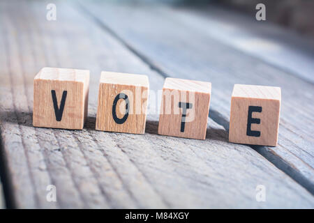 Macro Of The Word Vote Formed By Wooden Blocks On A Wooden Floor - Stock Photo