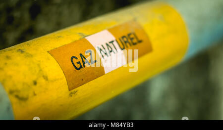 yellow gas pipeline on which is written in French - natural gas in france - Stock Photo