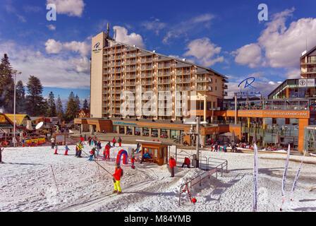 Rila Hotel and beginners drag lift at Borovets Ski resort, Targovishte, Bulgaria. - Stock Photo
