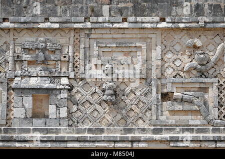 Mayan carvings at the Nunnery Quadrangle in Uxmal, Mexico - Stock Photo